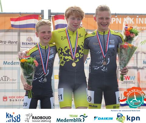 Chris Berkhout (2e) en Bas Kee (3e) op het podium